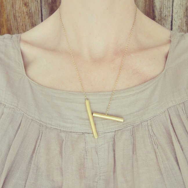 Gold stick necklace by Tanja Ting